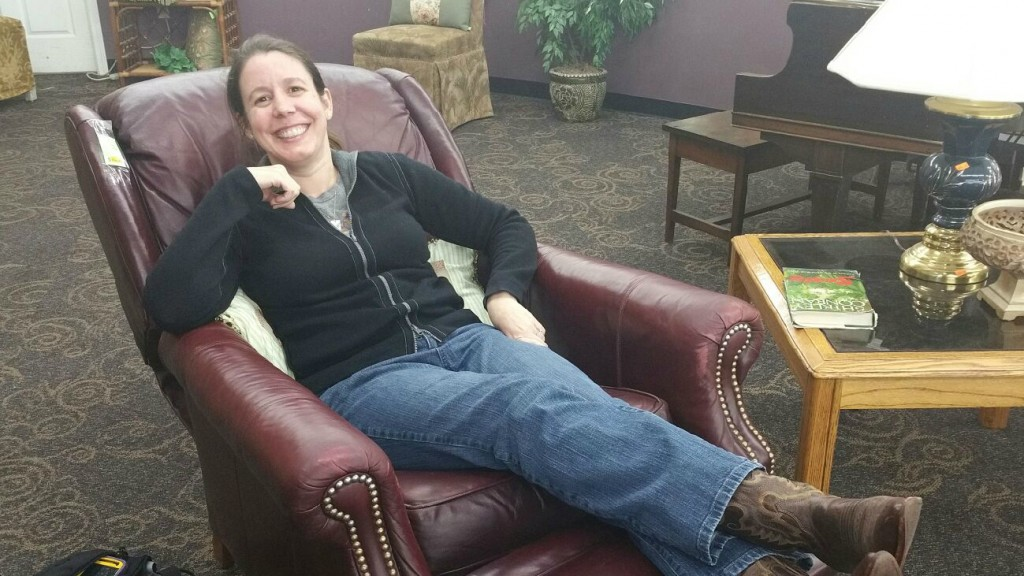 Testing out the leather recliner at the thrift store.