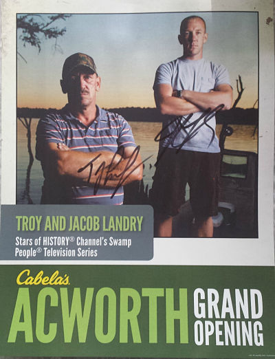 The autographed promotional flyer from the Acworth Grand Opening