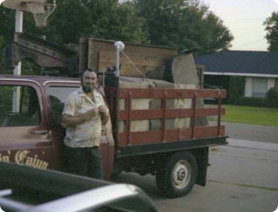 The Ragin' Cajun (Rodney) and his truck in the driveway of our house