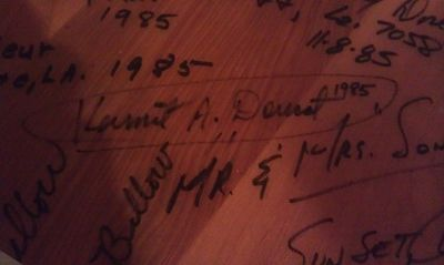 My father's signature on a table at the Steamboat Warehouse Restaurant