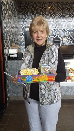 My mom and her kiddie box of treats the last time we went to the movies at The Grand on Johnston in Lafayette