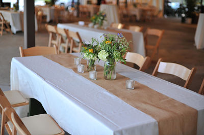 Table decorations at a traditional Cajun wedding - simple, no seating or table assignments