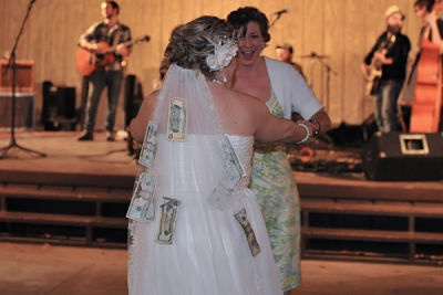 The bride dances with guests in exchange for money in the money dance.