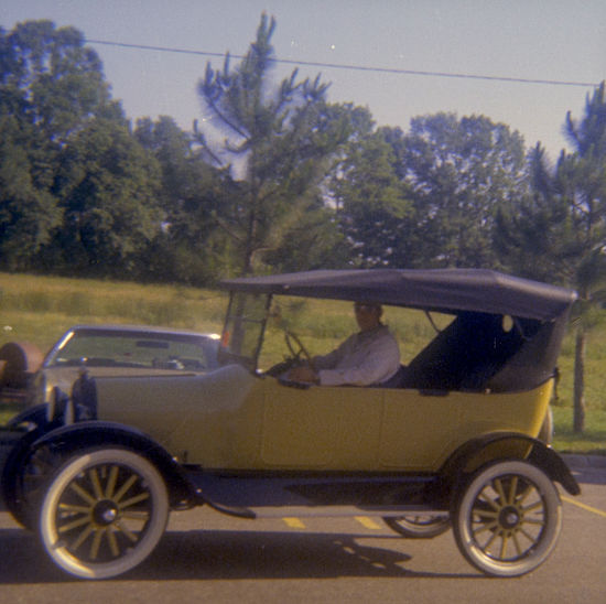 My father driving yellow bird in the early-mid 1970's, just after completing the restoration