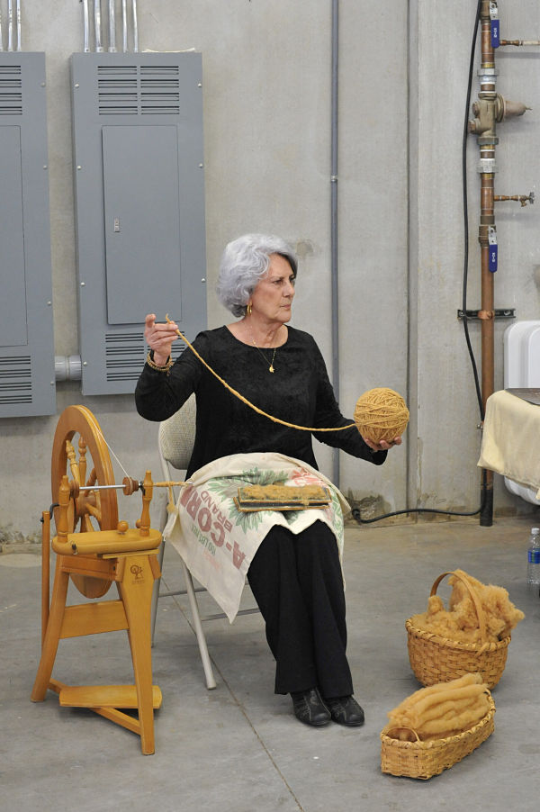 Elaine Borque demonstrating carding and spinning brown cotton at the Coton Jaune screening in Atlanta